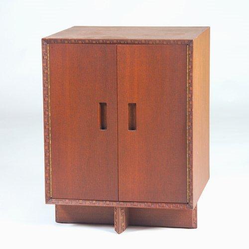 1017: FRANK LLOYD WRIGHT/HENREDON Two-door cabinet in t