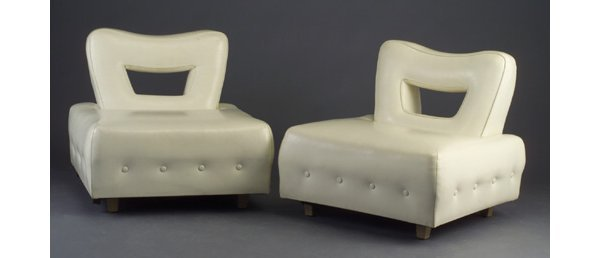 23: Pair of lounge chairs attributed to James
