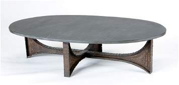 49: PAUL EVANS Sculpted Steel coffee table with oval sl