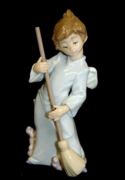 """9: Lladro #5726 entitled """"Sweep Away The Clouds"""""""