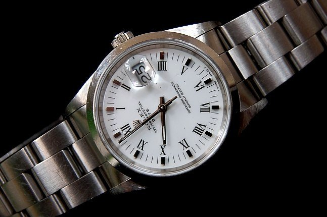 98: Rolex men's mid-size Oyster Perpetual Date 15200
