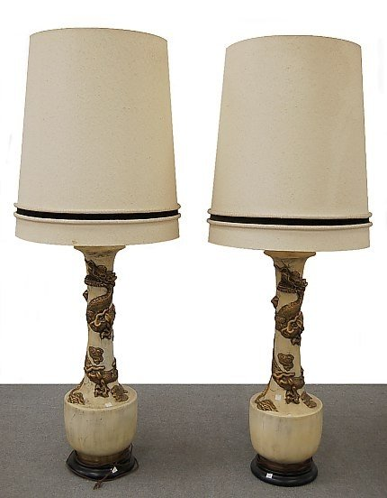 9: Pair of tall matching dragon form lamps