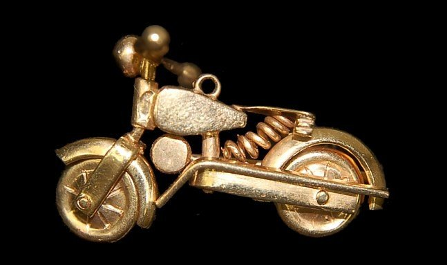 17: 18K rose gold articulated motorcycle charm 1930's
