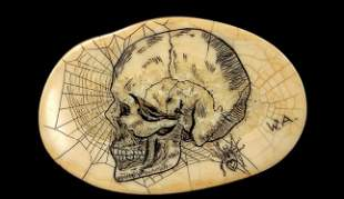 Ivory tusk scrimshawed with a skull and spider
