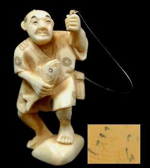 Japanese carved ivory figurine