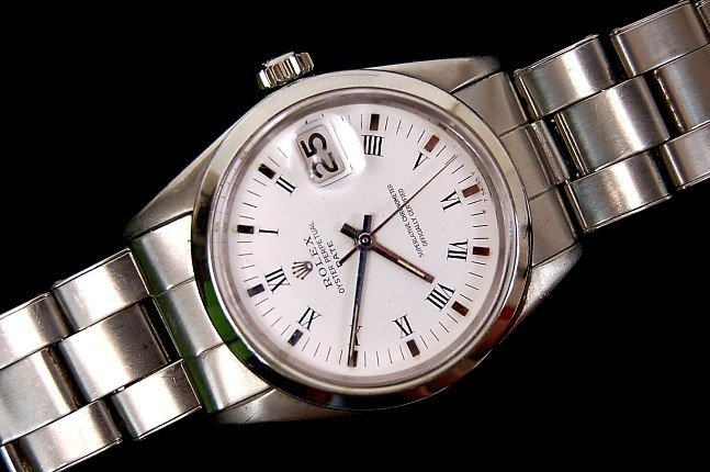 105: Rolex Oyster Perpetual watch near mint
