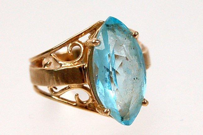 7: 10K navette blue topaz ring