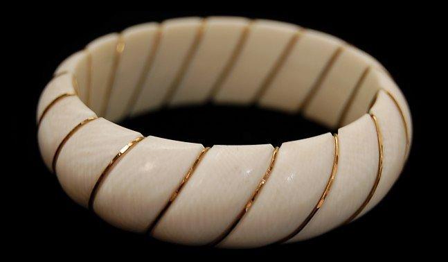 21: Solid carved ivory 14K bangle