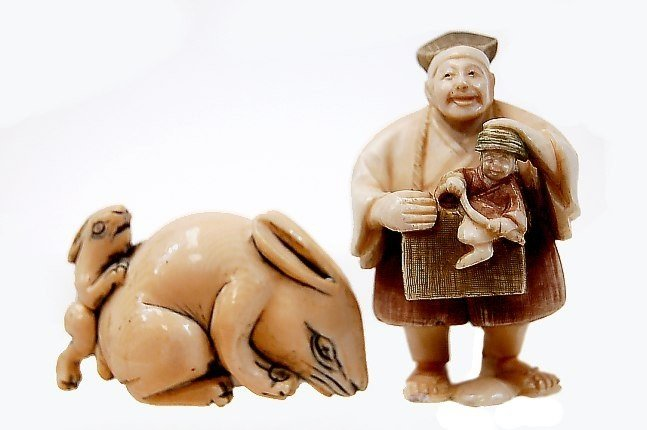 13A: Pair of Japanese carved ivory netsukes