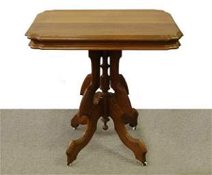 Eastlake table with porcelain rollers