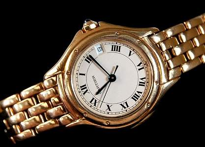 101: Cartier lady's 18K Panther watch