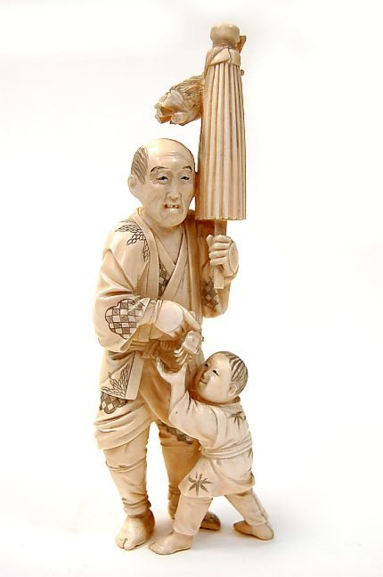 "54: Chinese carved ivory 7.25"" figure of a man teasing"