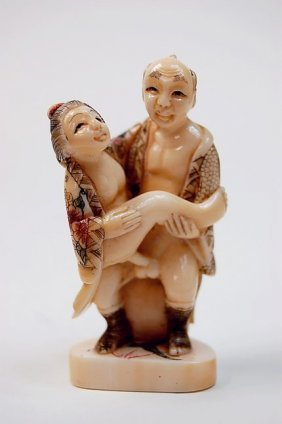 20: Japanese erotic ivory carving depicting an amorous