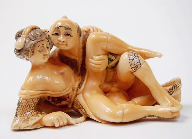 24: Japanese erotic ivory carving depicting an amorous