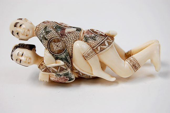 58: Japanese erotic ivory carving depicting an amorous