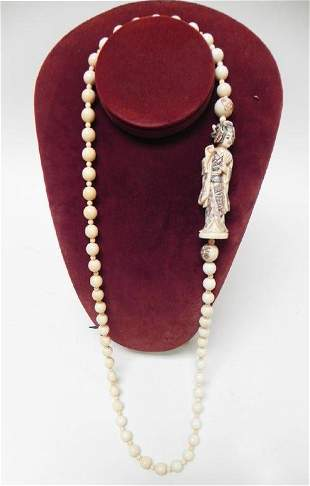 Carved ivory beaded necklace with netsuke figure