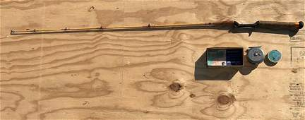 Antique signed fishing rod and reel