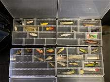 Lot of fishing lures and cases and soft tackle box