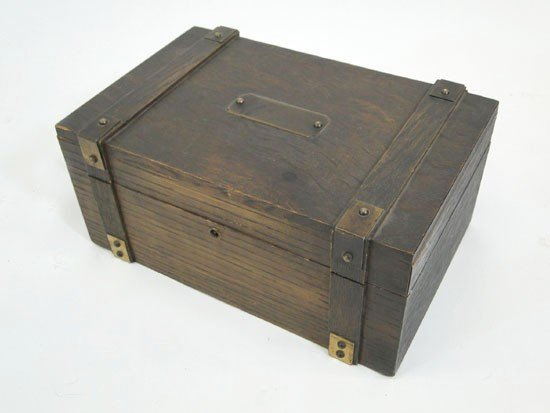 12: Arts and crafts oak banded humidor with porcelain l