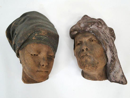 14: Pair of folk art hand carved wooden heads of a male