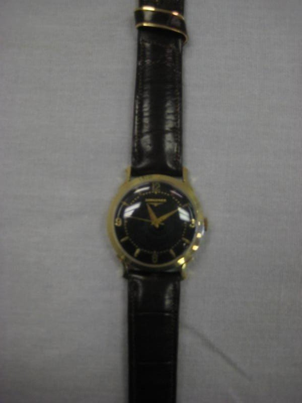 44: Late 1950's early 1960's 14K gold men's Longines wr
