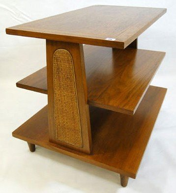 15: Three tiered graduated end table with caned sides.