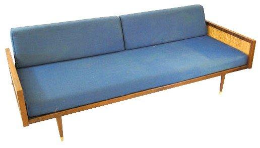 18: 1960's three cushon sofa with walnut trim caned sid