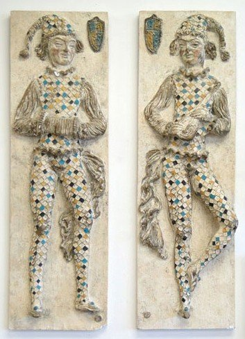 22: Two plaster wall placques depicting jesters – late