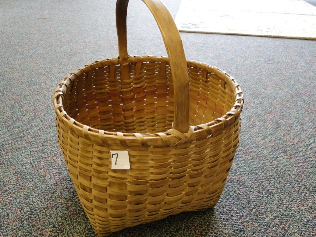 7: Rounded hand woven Winnebago basket w/ hand carved b