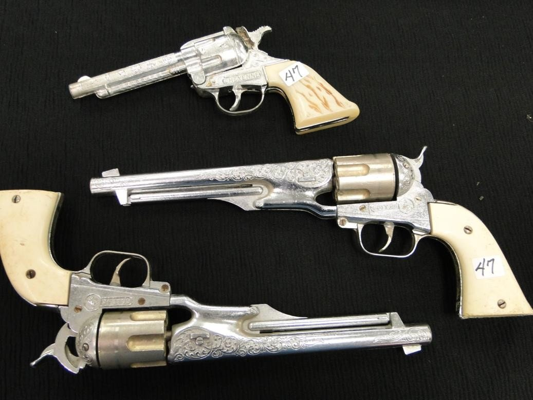 47: A pair of Colt 45 childs cap guns along with a Chey