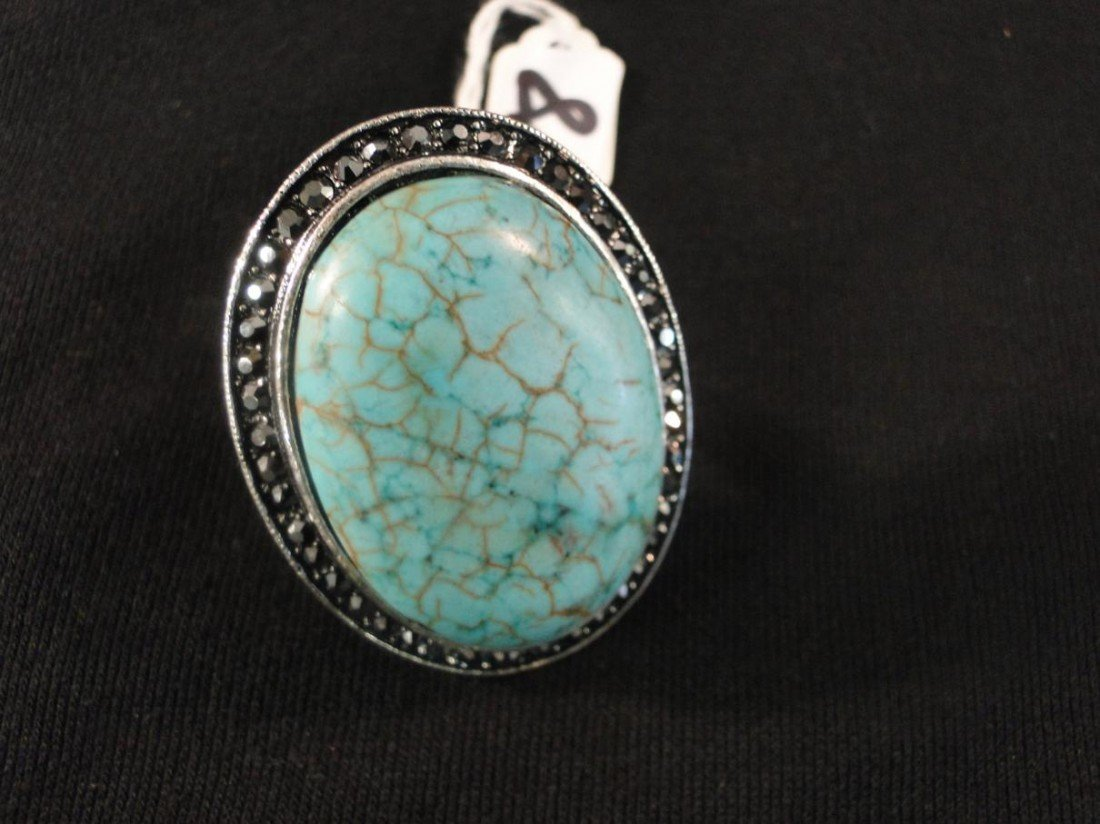 18: Immense real turquoise stone with cut marquisite su