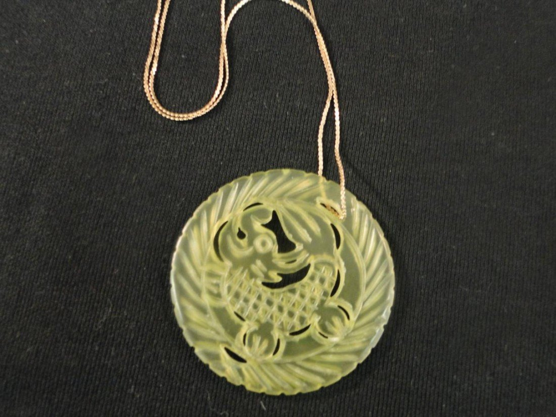24: A dragon carved large jade pendant measures 2.25 in