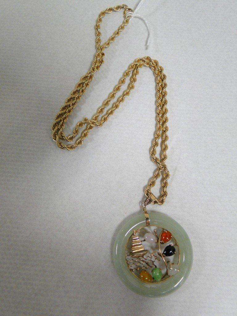 5: Carved jade medallion with semi precious stones set