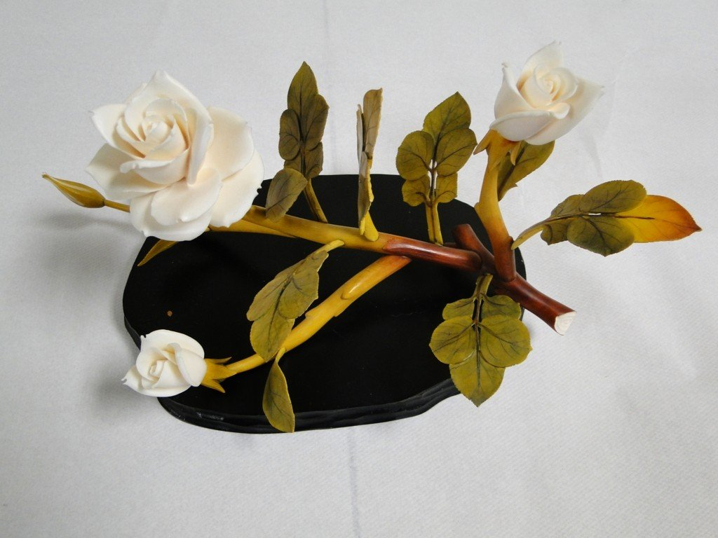 15: Stunning Oriental hand carved ivory rose branch wit