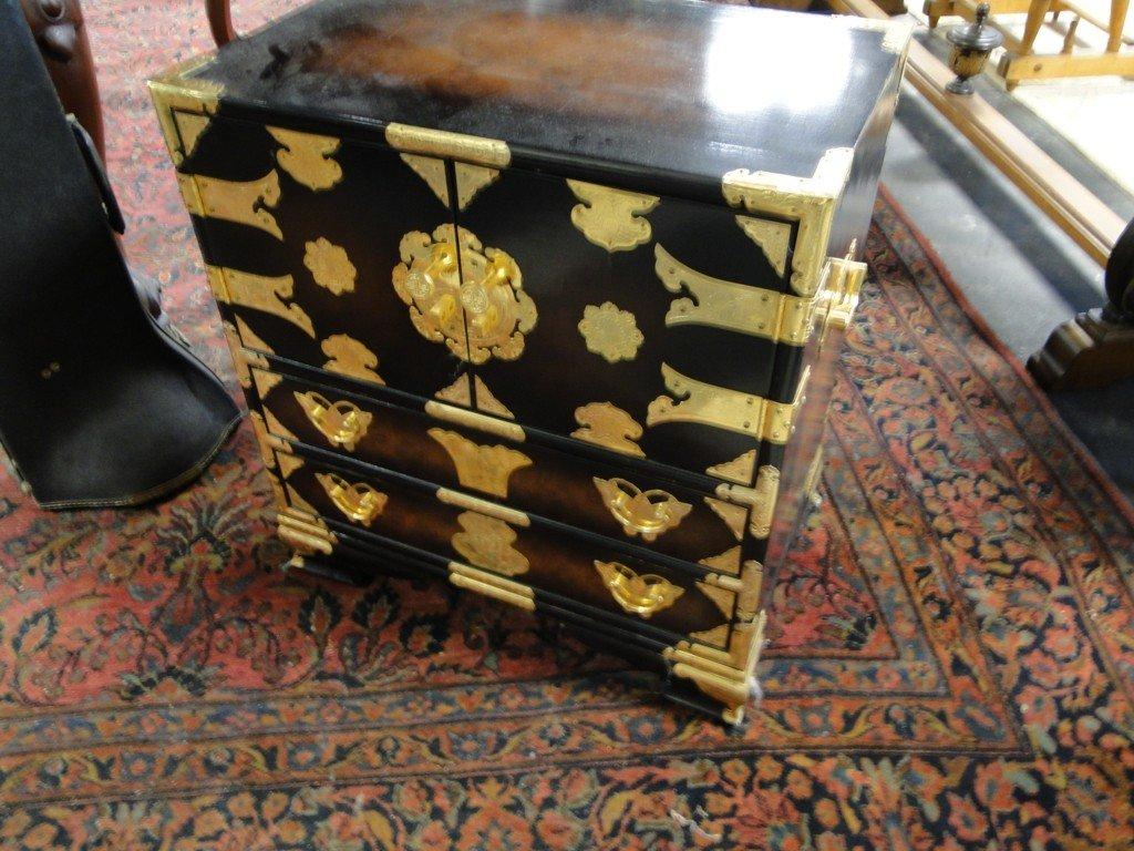 21: Contemporary brass trimmed Oriental storage cabinet
