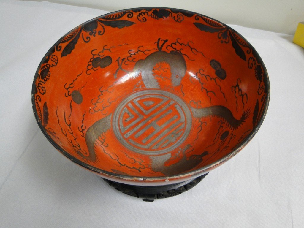 23: A large red glazed Oriental bowl with stand in exce