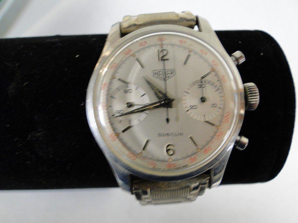 29: Heuer, Gubelin men's time/date/stop watch with orig