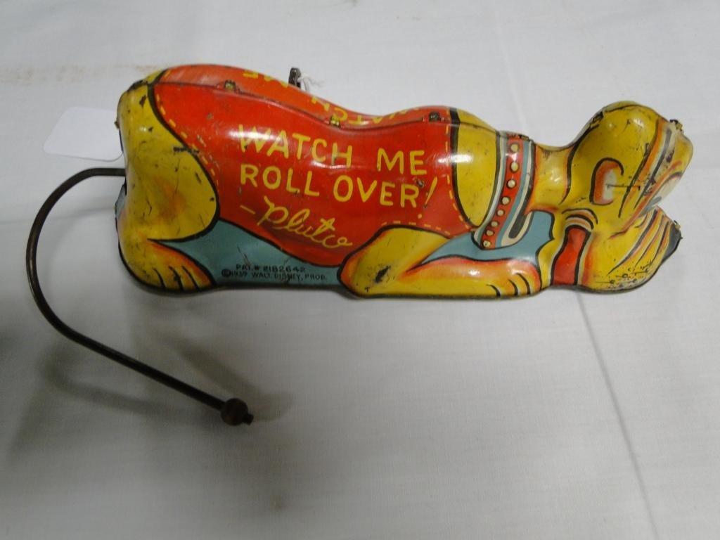 5: Pluto rollover tin lithograph dog by Walt Disney 193