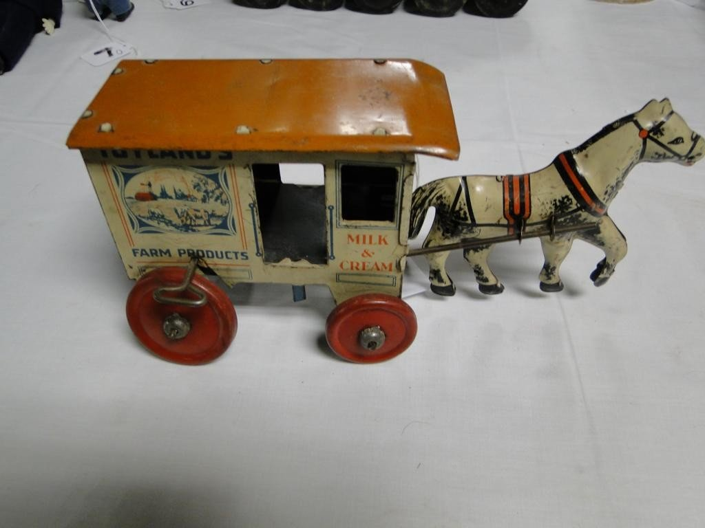 10: Toyland tin lithograph key wind horse and carriage