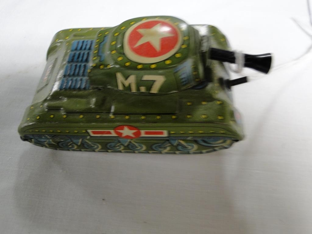 """11: Tin lithographed toy friction tank by Cragstan; 3""""L"""