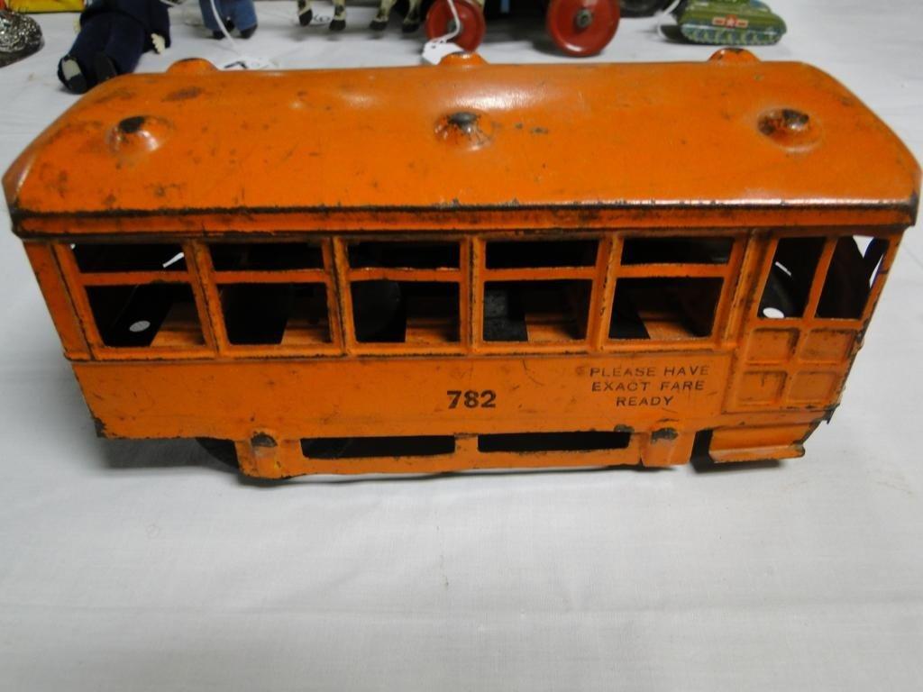 12: Tin lithographed key wind trolley car;#782, key win