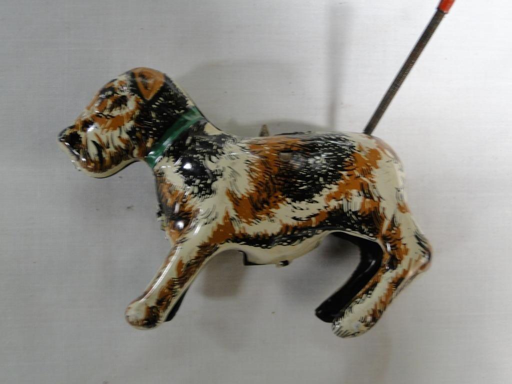 15: Tin lithograph key wind dog