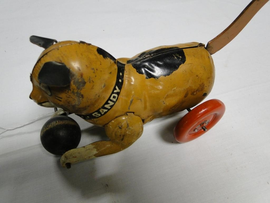18: Friction toy  tin lithographed Sandy the Cat with o