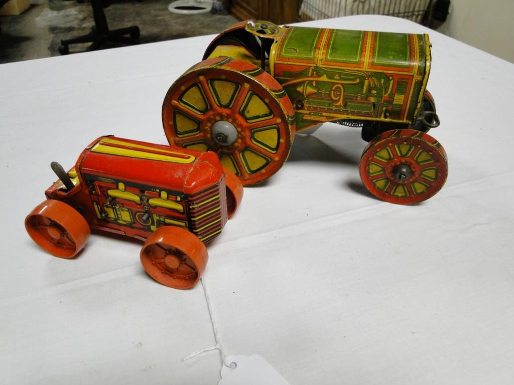 19: Two tin lithographed key wind tractors missing the