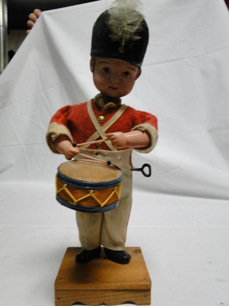 21: Key wind celluloid toy drummer with stand, made in