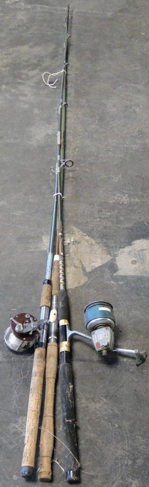 19: Three lake Michigan fish rods one with reel