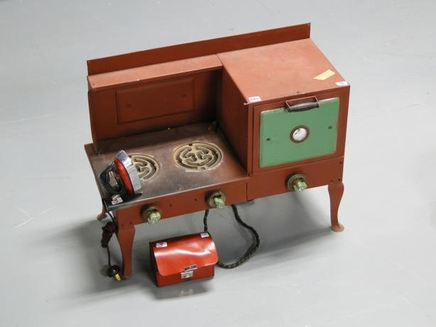 3: 1920's working doll stove, along with a doll iron in