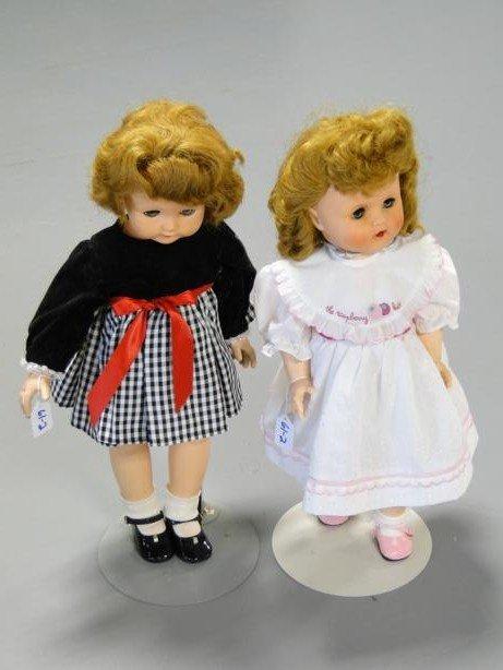23: Two 1950's plastic, fancy dress dolls with sleep ey