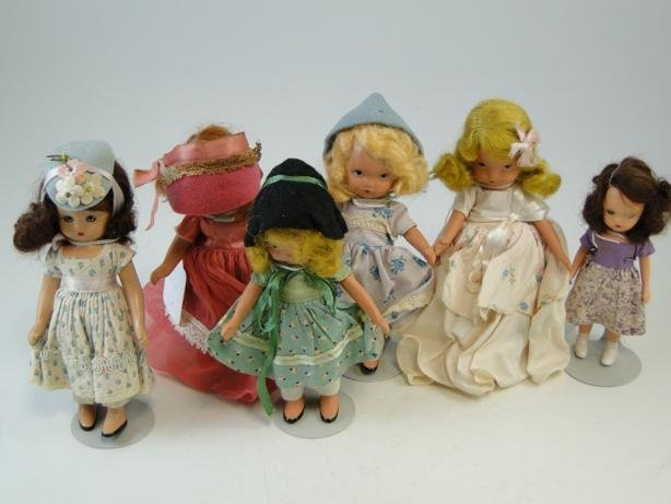 24: Group of six composition story book dolls in excell