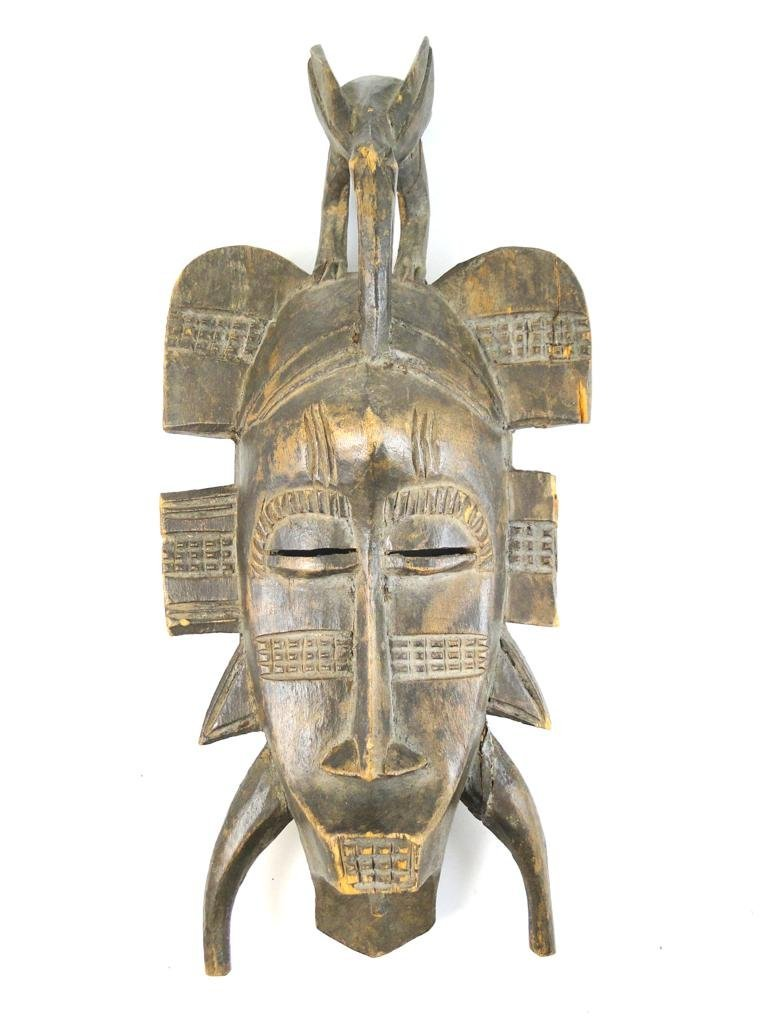 9: Kpelie Mask, Senufo tribe, from Ivory Coast, obtaine